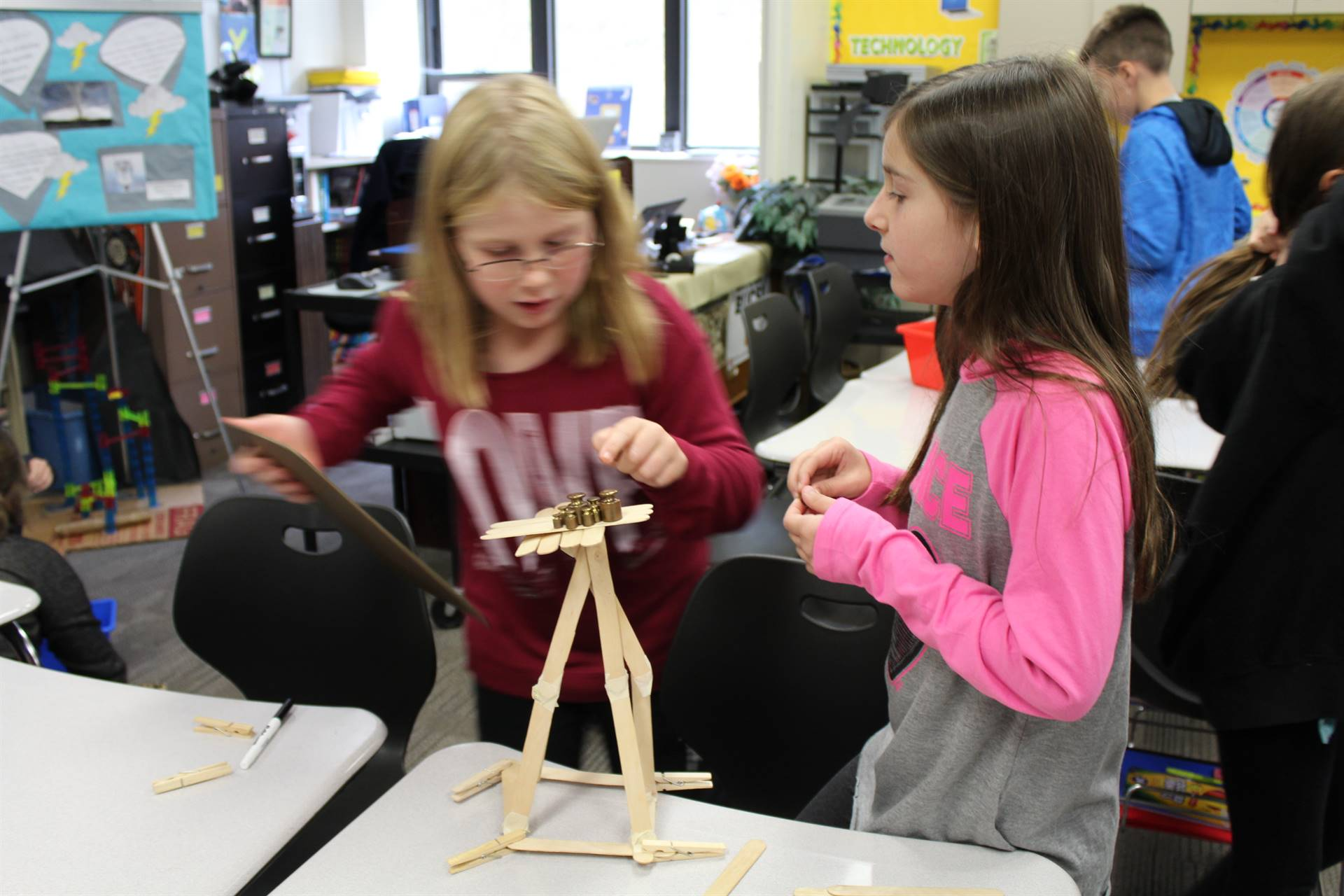 Two students working on the Weekly STEAM Challenge
