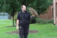 Mr. Davis holds the owl