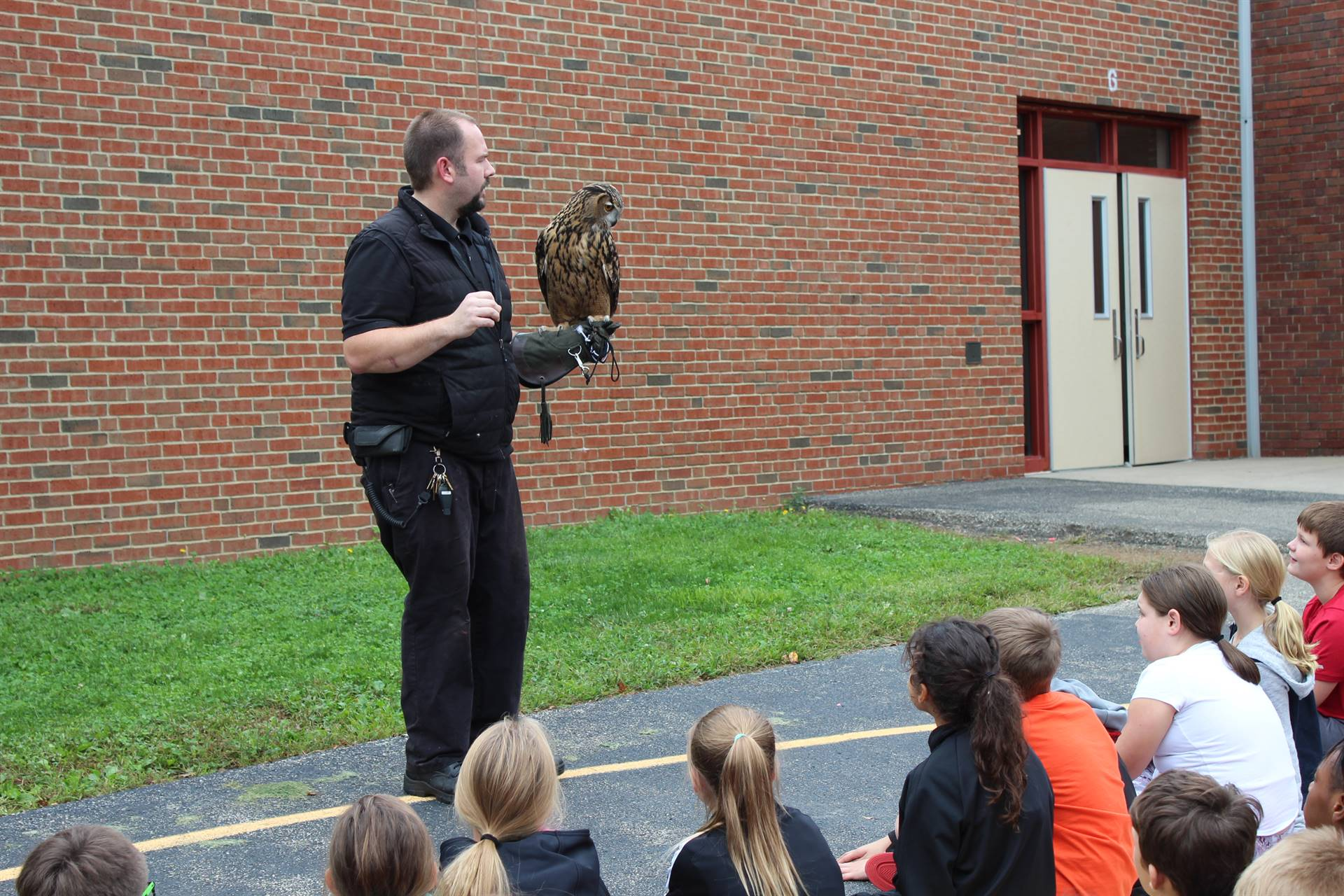 Mr. Davis talking to the students about the owl