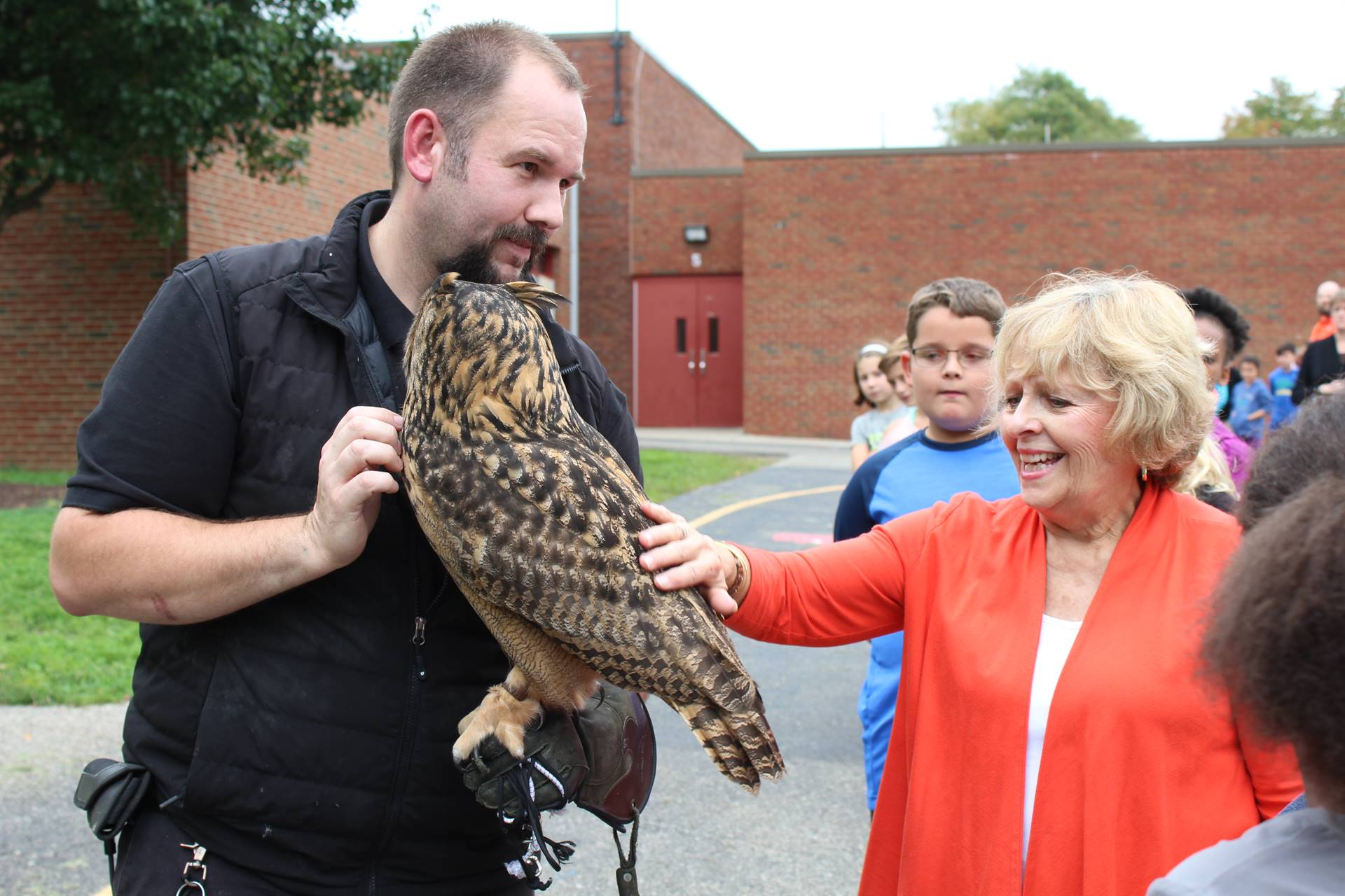 Mrs. Strotz petting the owl
