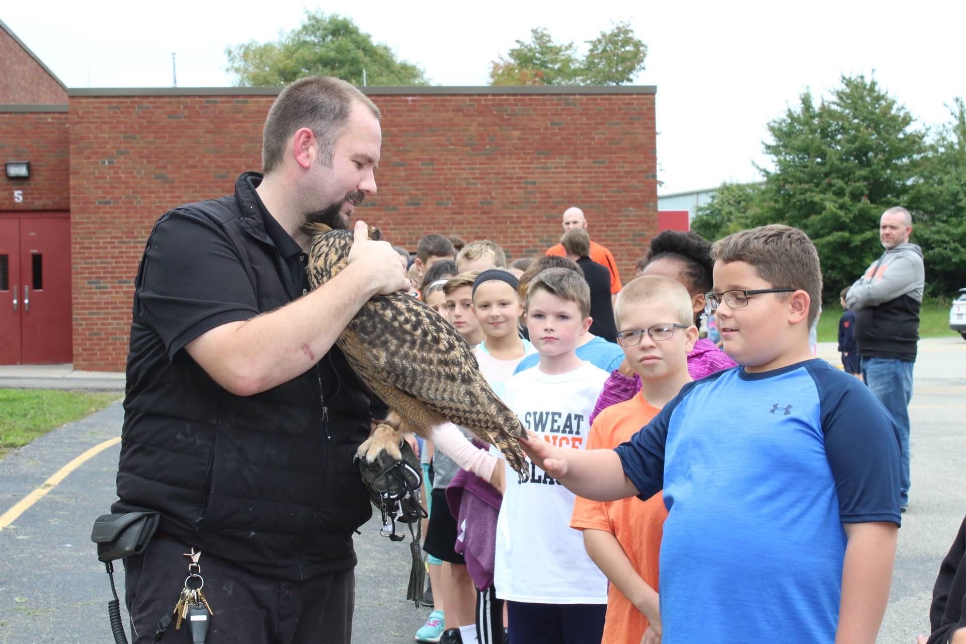 Student petting the owl