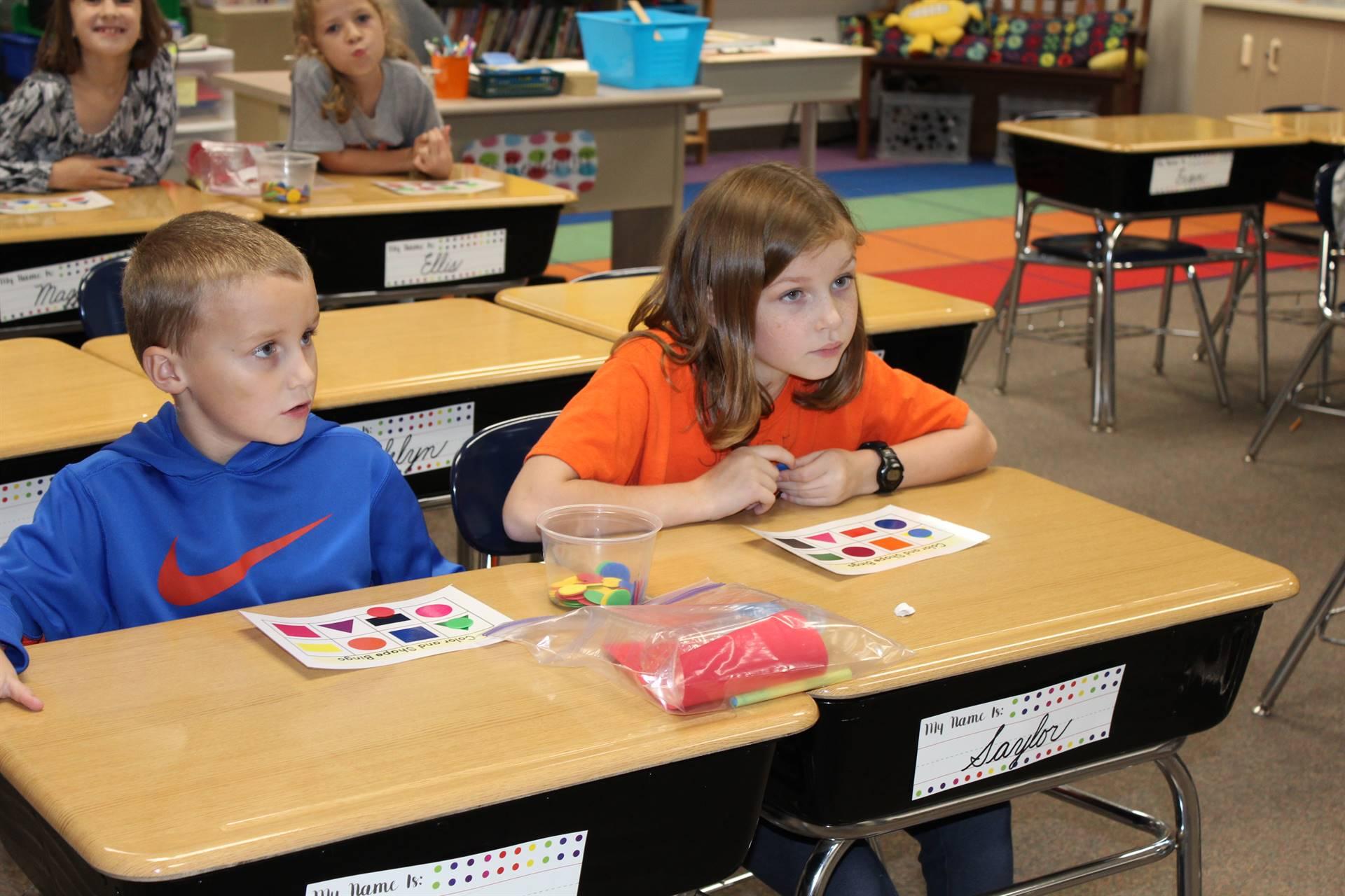 Two students playing Shape Bingo