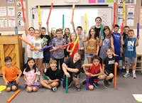 Miss Ziegmann and the students with their boomwhackers