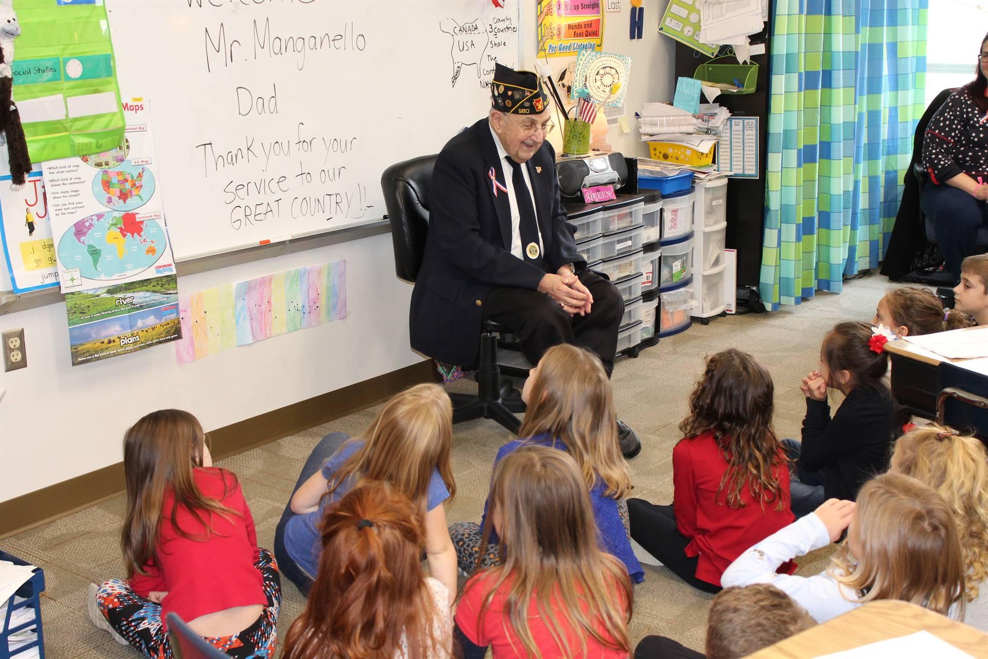 Veteran talking to students