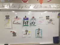 The nine mascots on a bulletin board