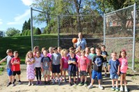 Mr. Lenosky and the students on the kickball field