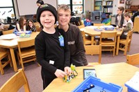 Two students with their robot