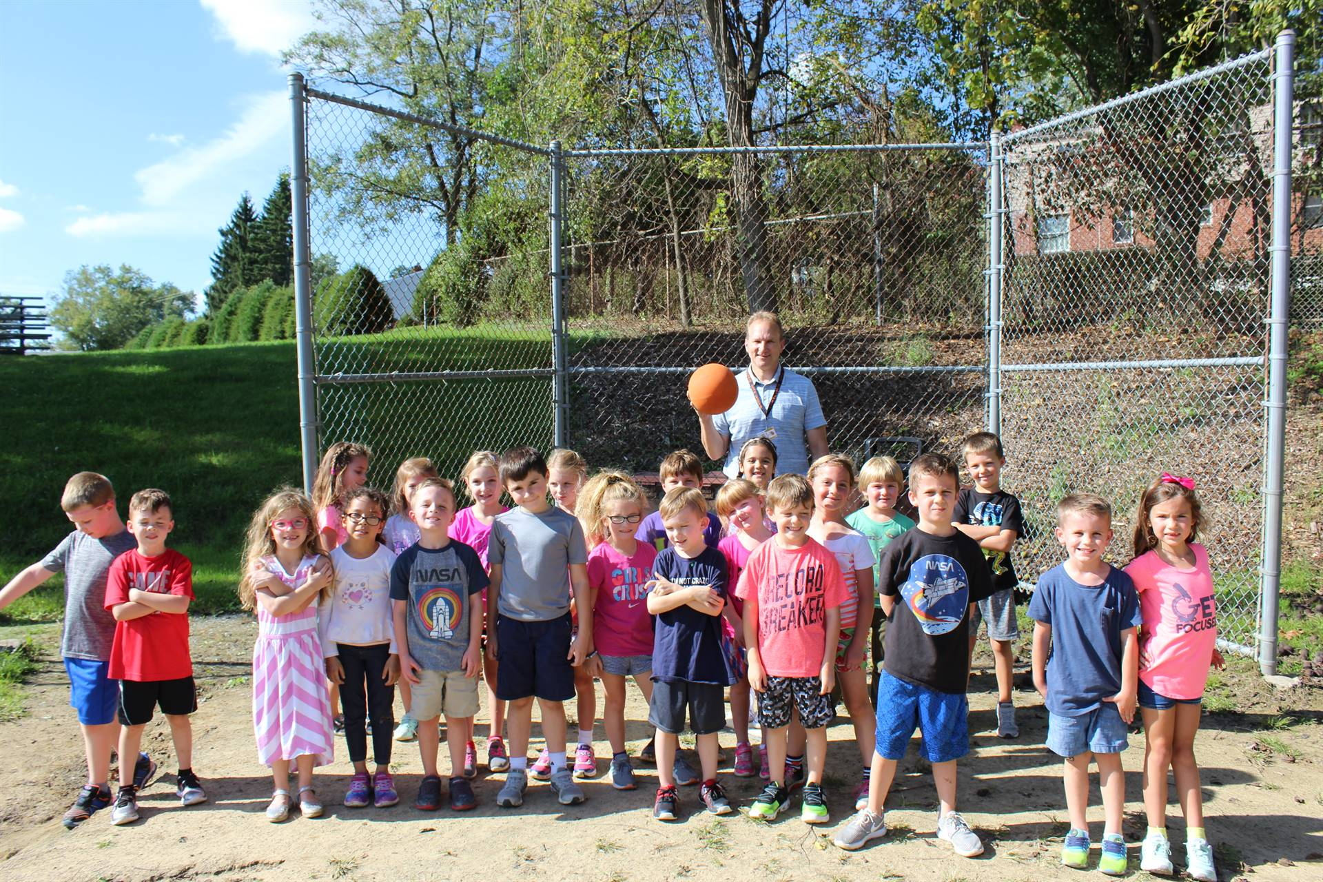 Mrs. Joseph's students and Mr. Lenosky on the field to play kickball