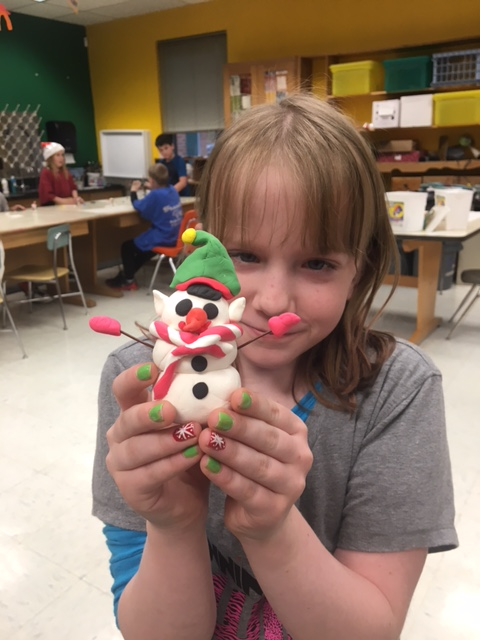 Student with a snowman