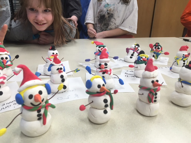 Student looking at snowmen