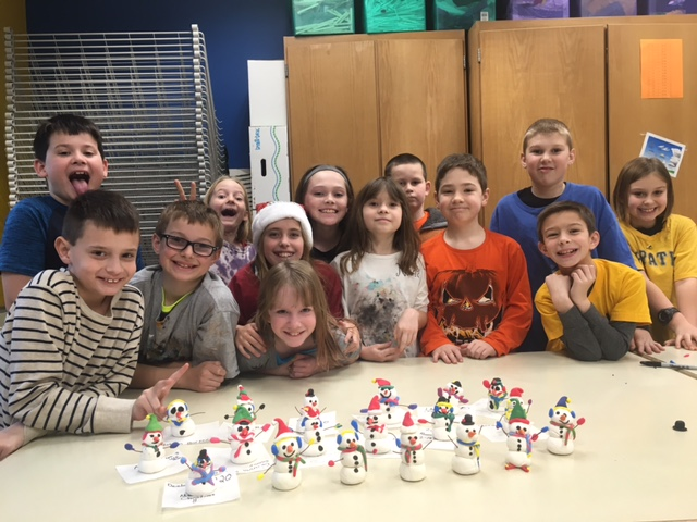 Students with their snowmen