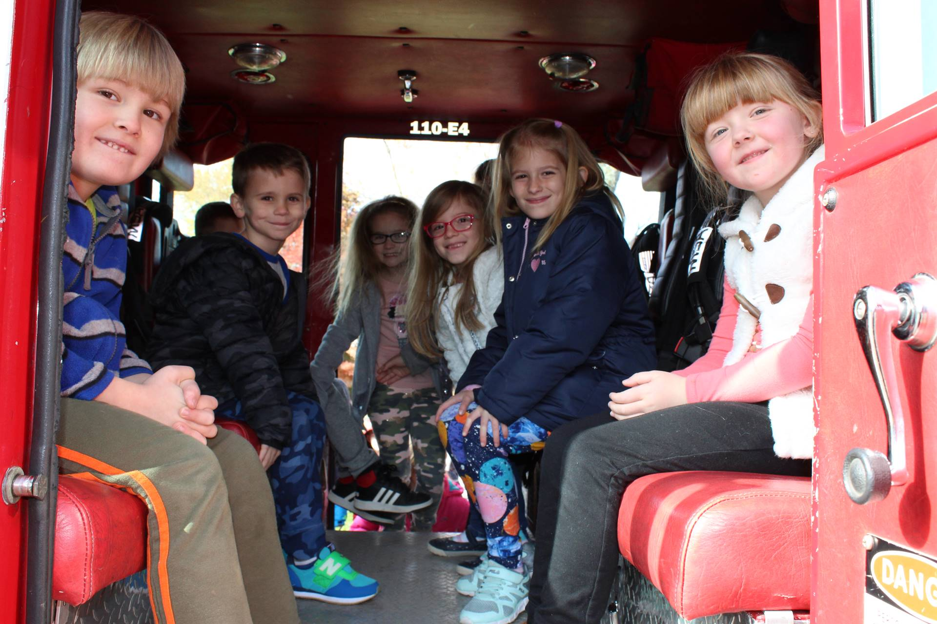 Six first graders in the back of a BPPD Fire Truck