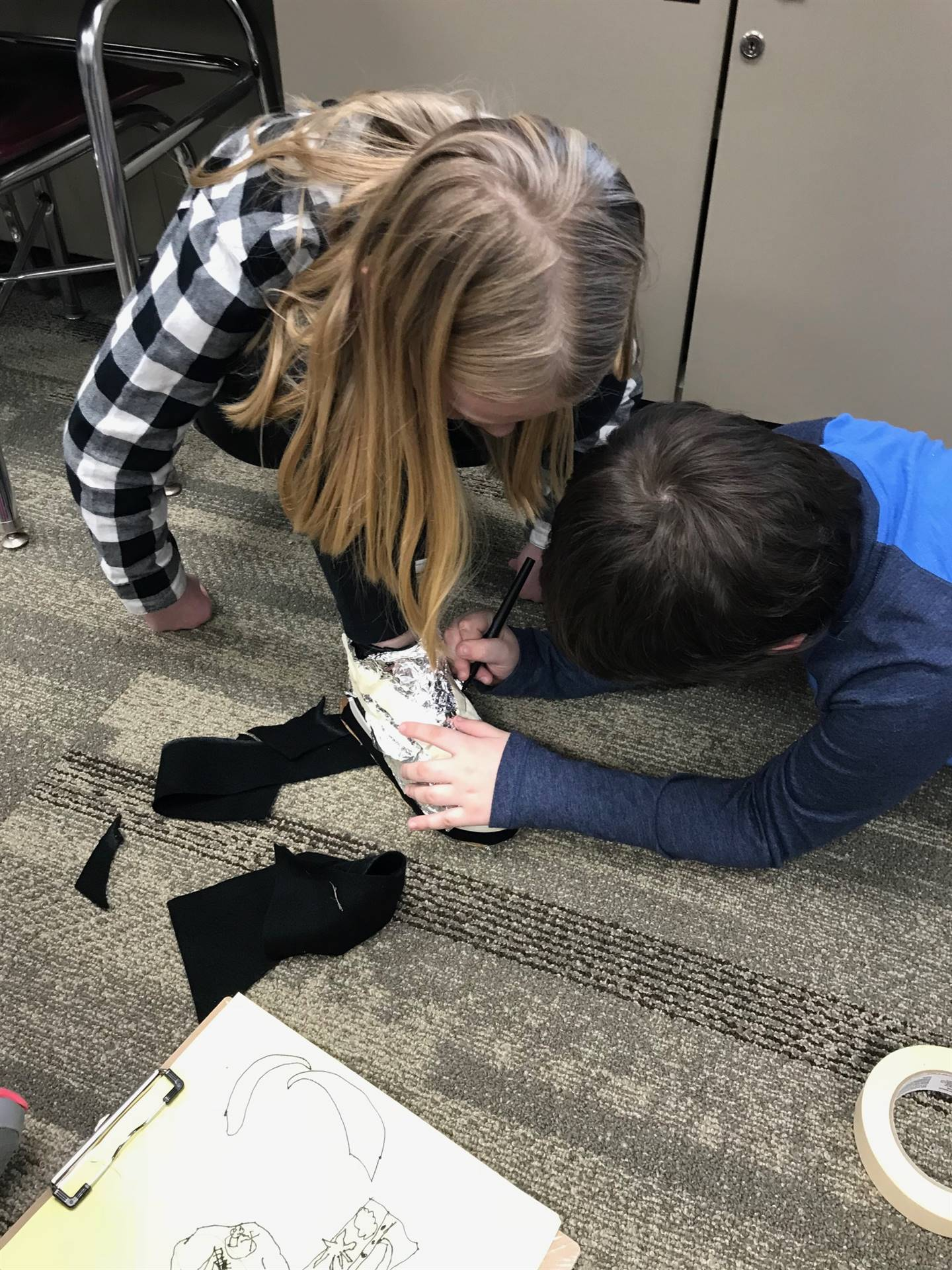 Student trying on the shoe