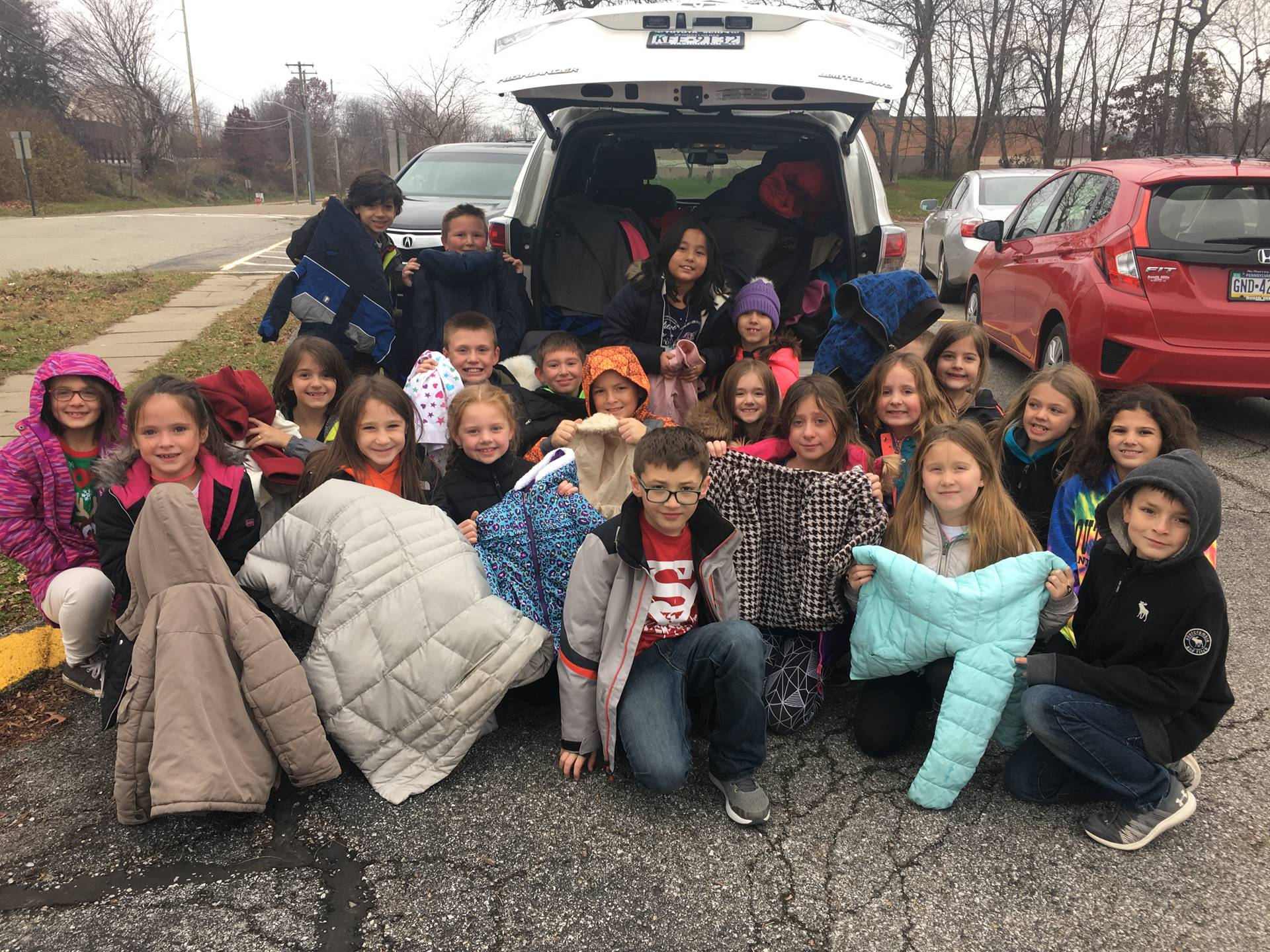 Third Graders with the coats collected during the Coat Drive