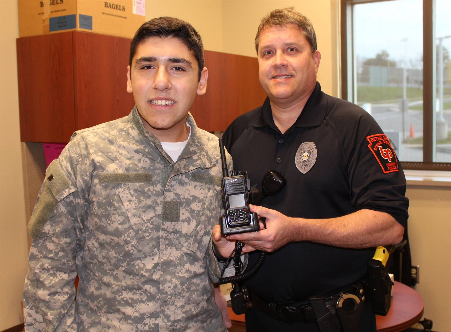 Blake Haggerty and Officer Kirsch with the new two-way radios that Blake recommended