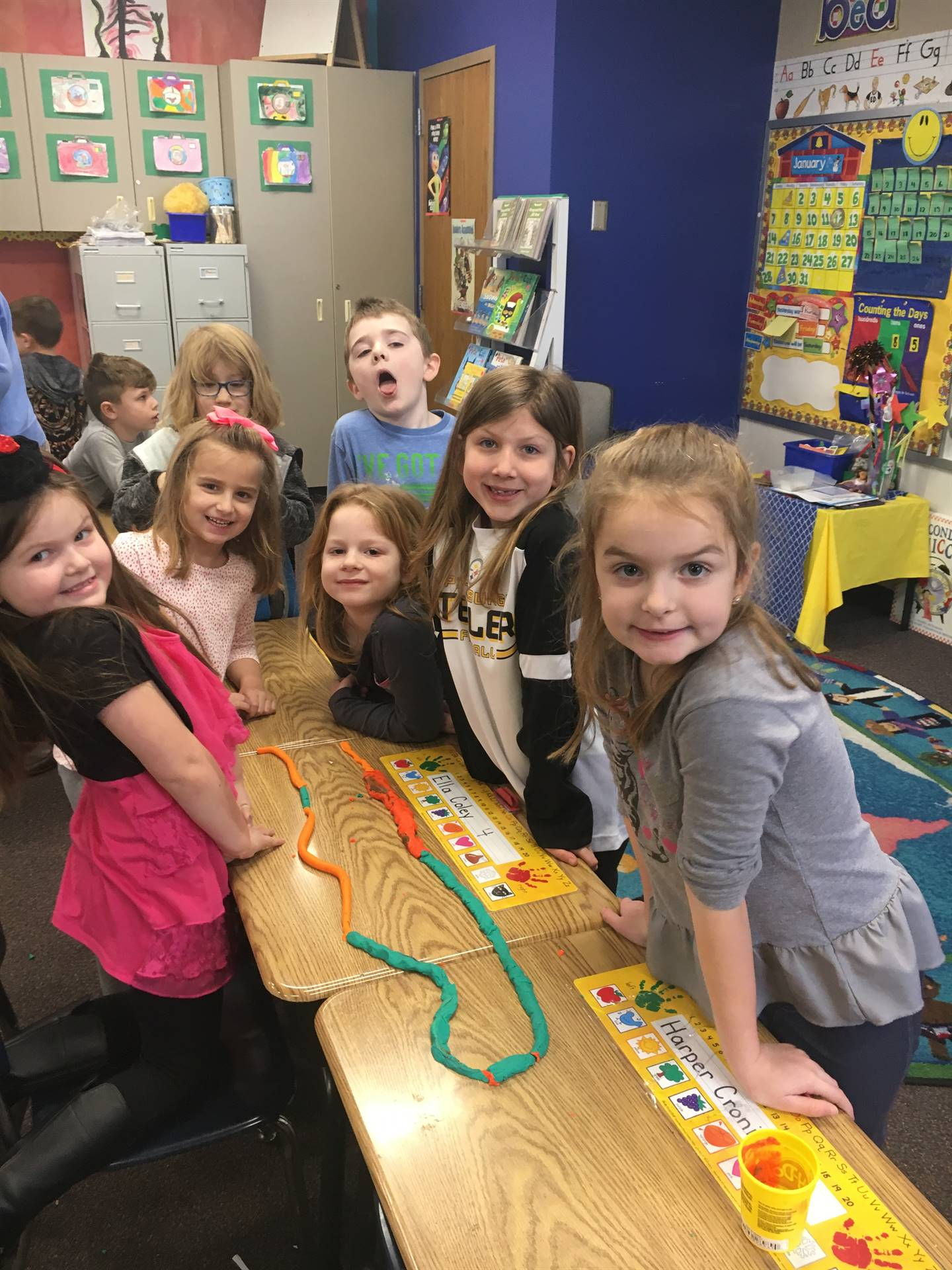 Students creating a Play Dough path