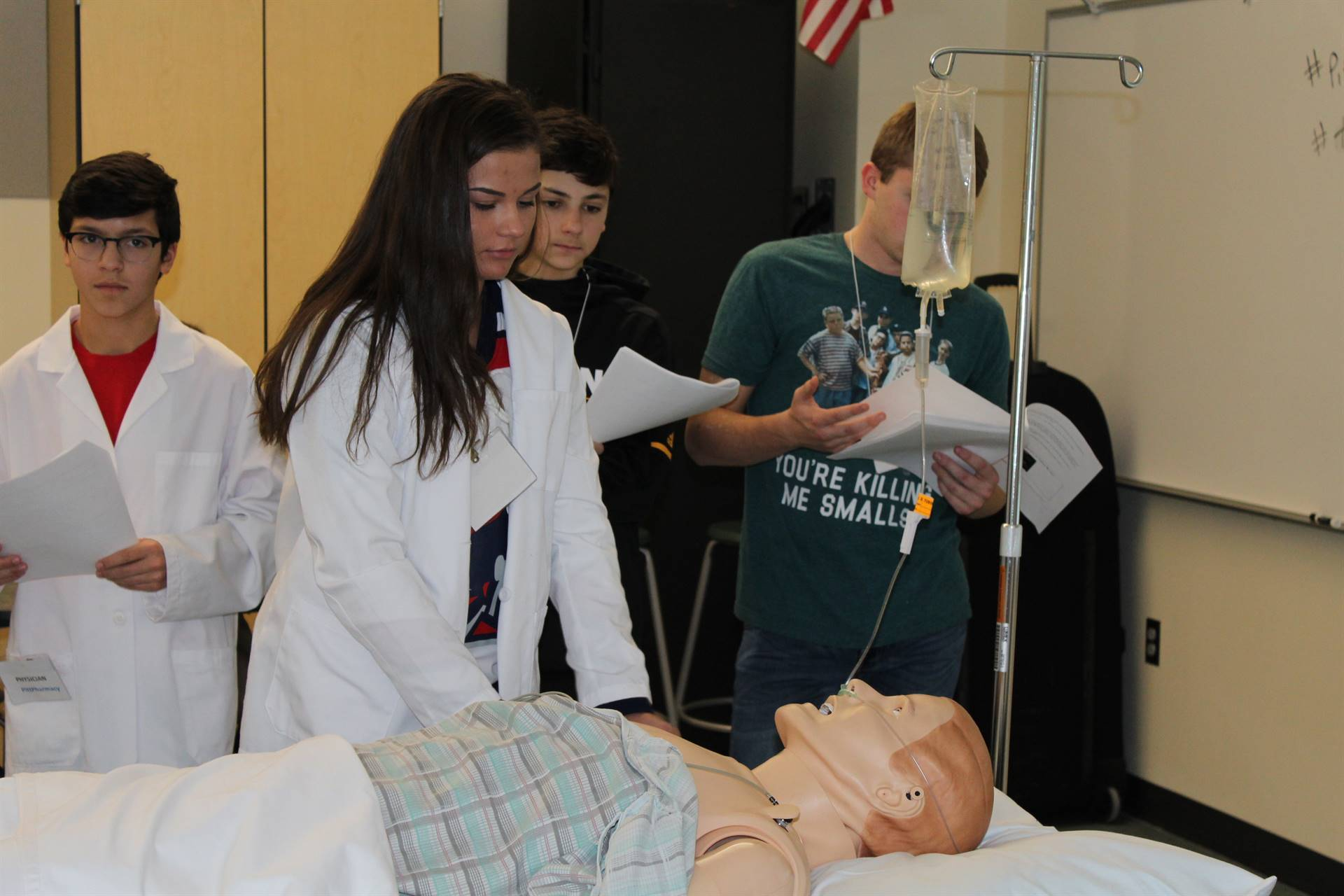 Student administering medication to the Sim Man
