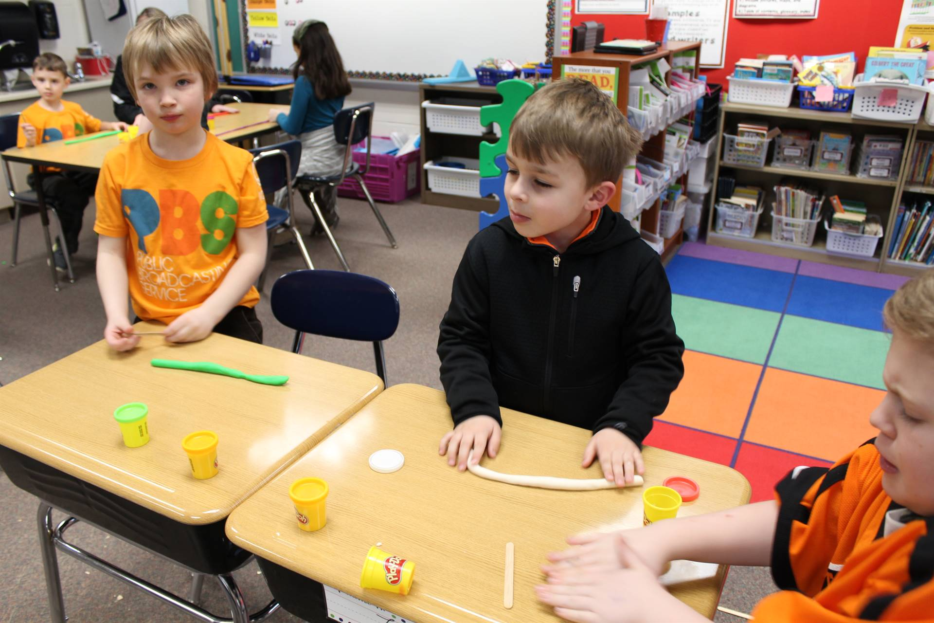 Students using Play Dough