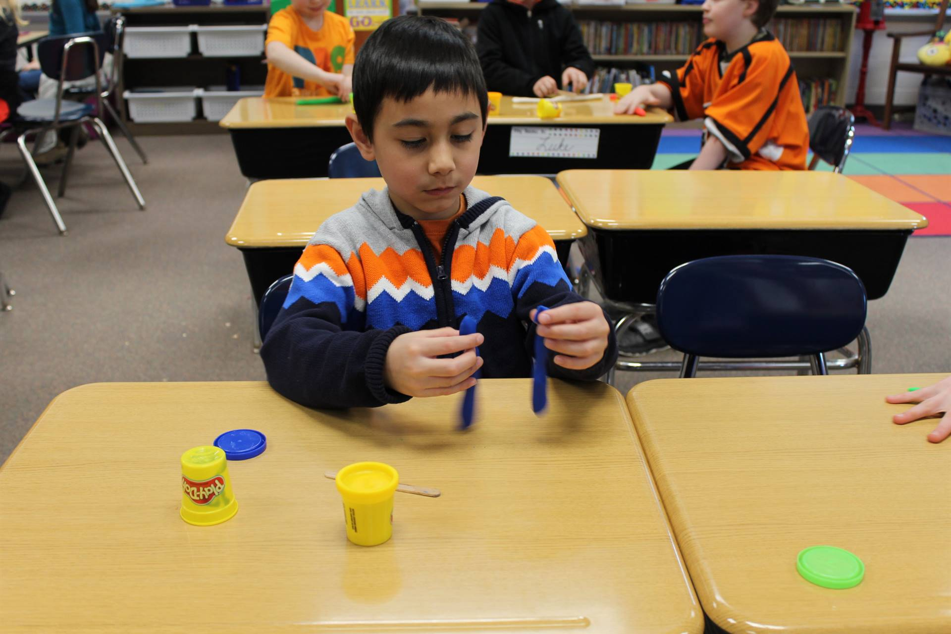 Student holding Play Dough
