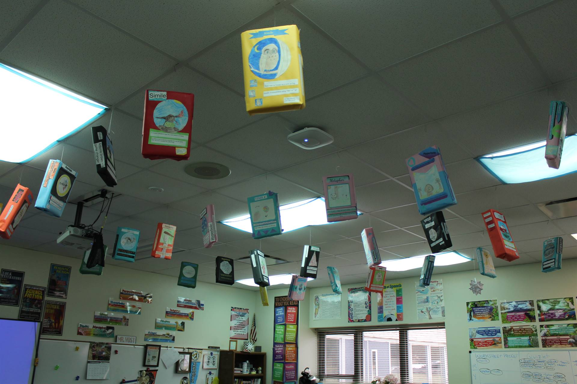 cereal boxes hanging from classroom ceiling