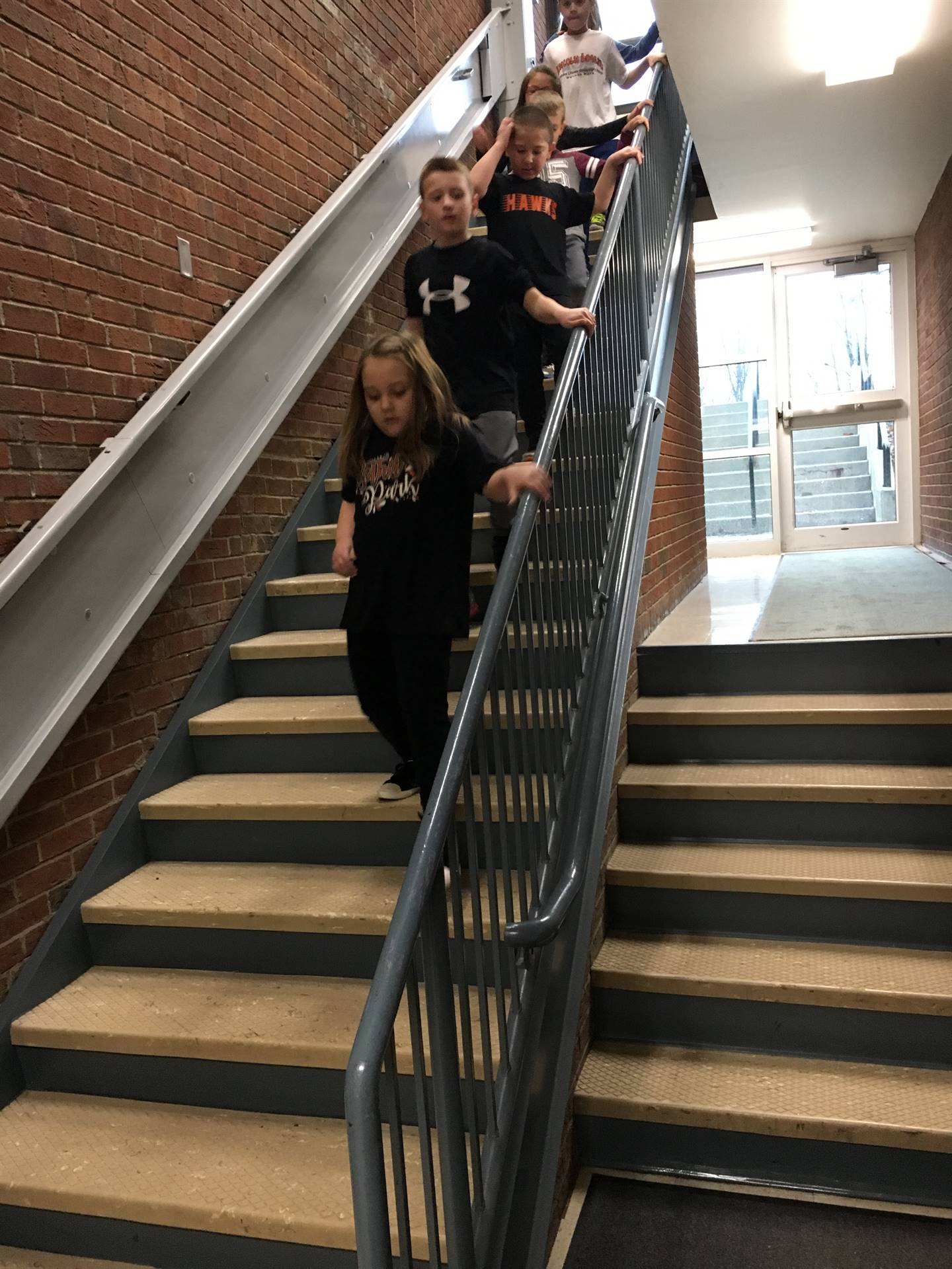 Students walking the steps