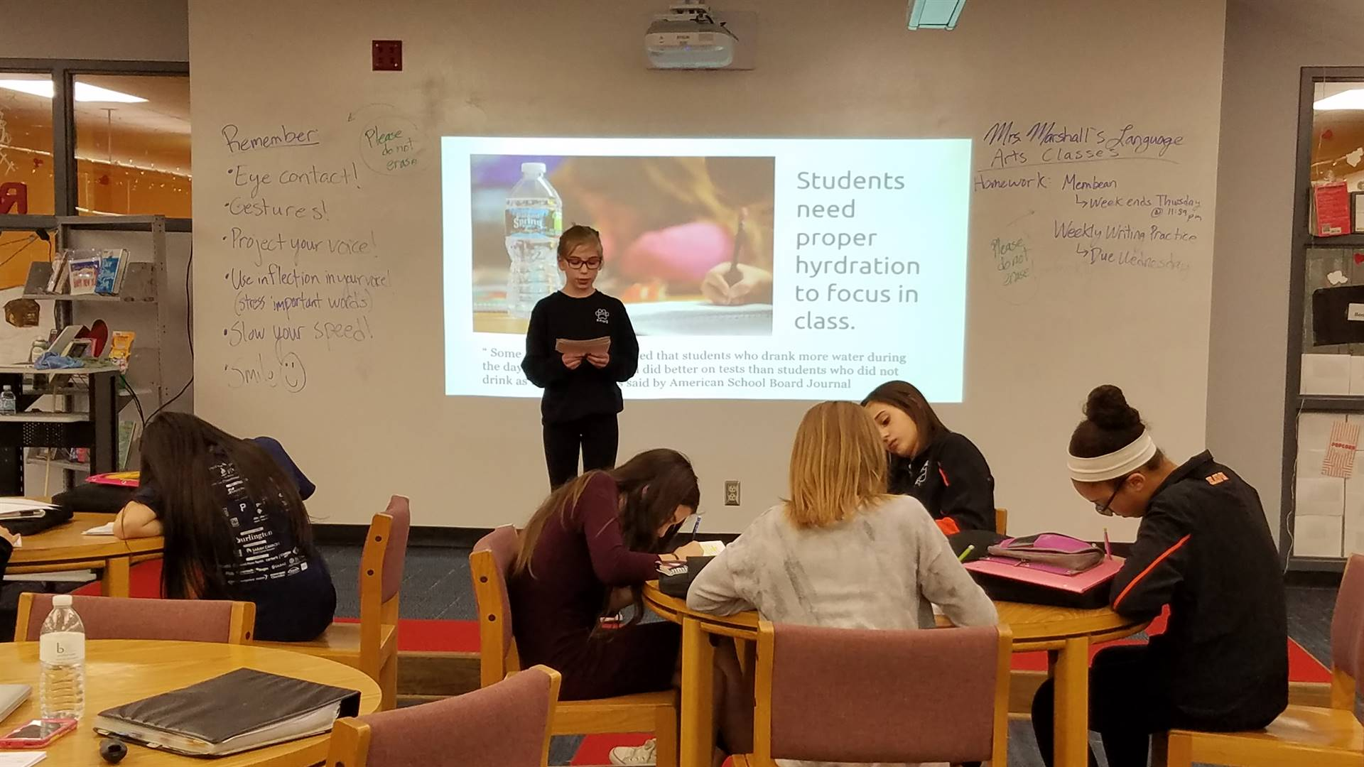 Mrs. Marshall's students persuade their audience to change a school handbook policy.