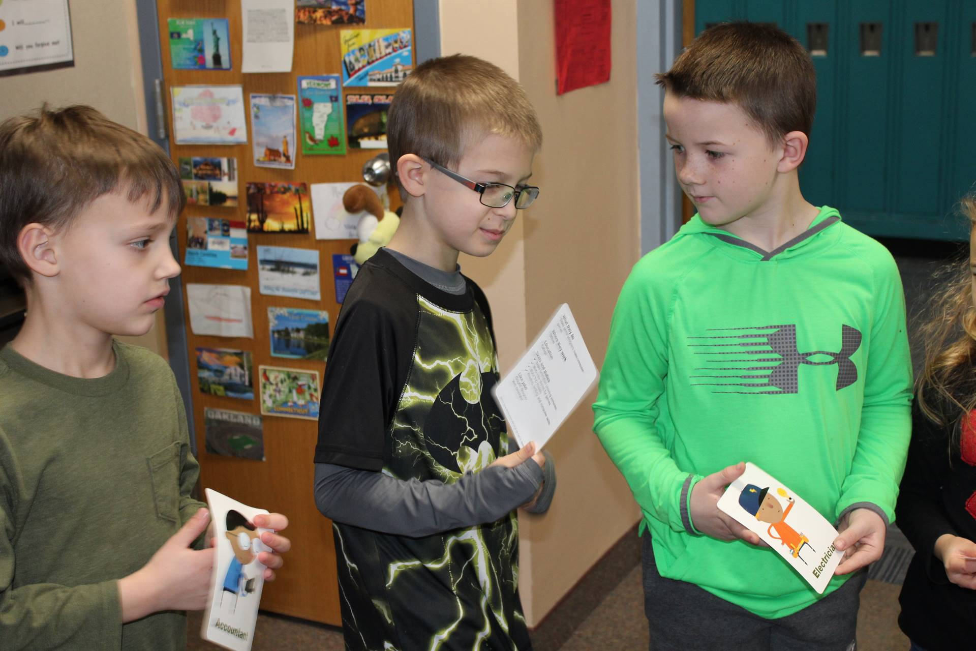 Franklin students holding flash cards