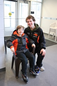 Hockey player with his friend