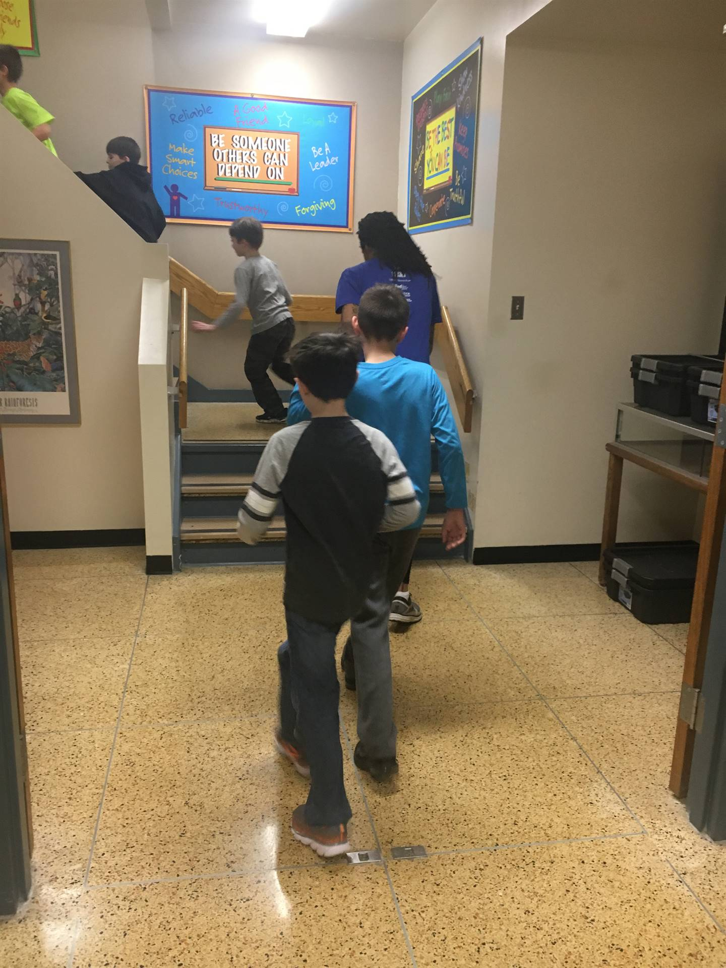 Lincoln students walking upstairs