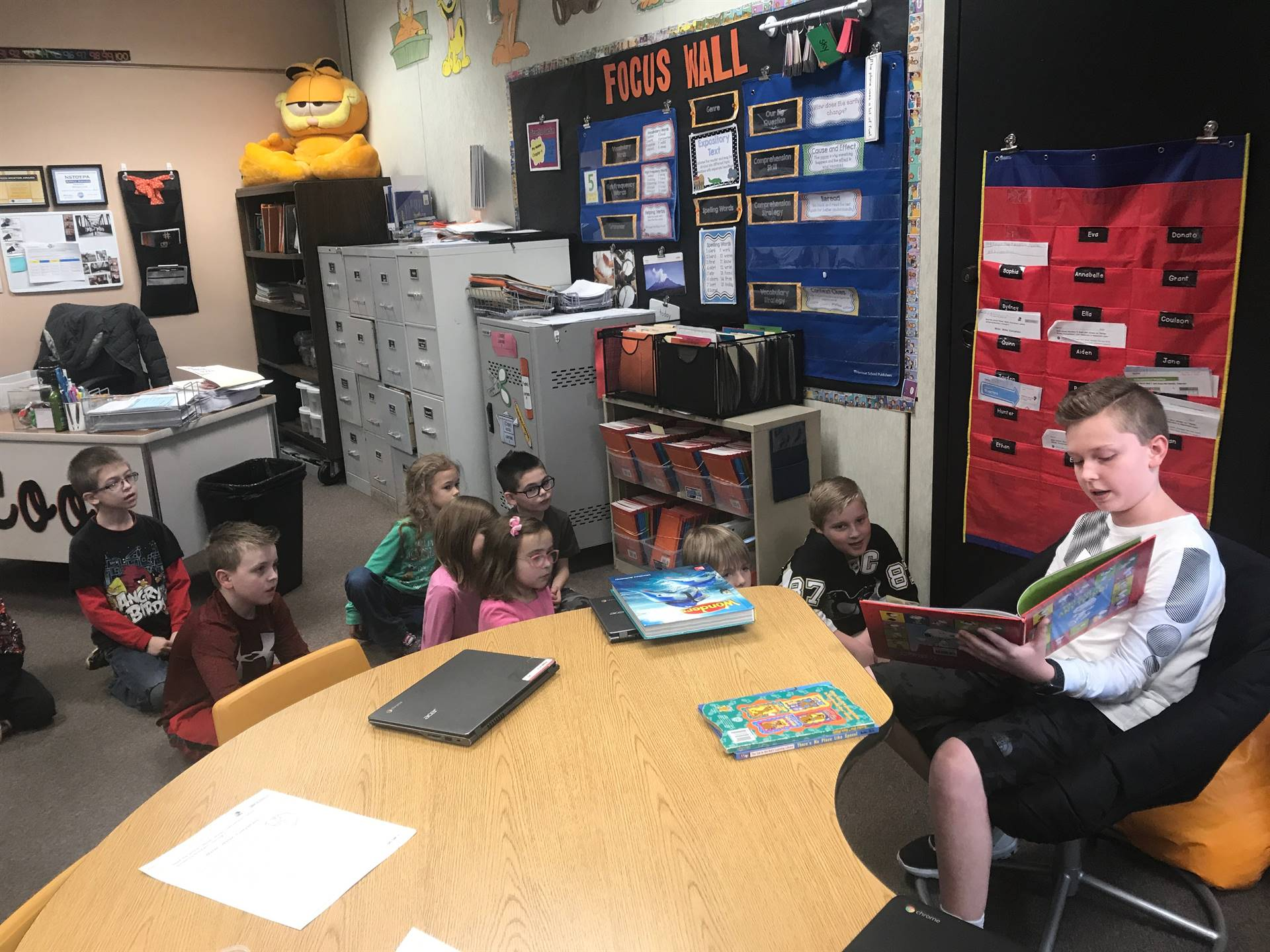 IMS student reading to Franklin students