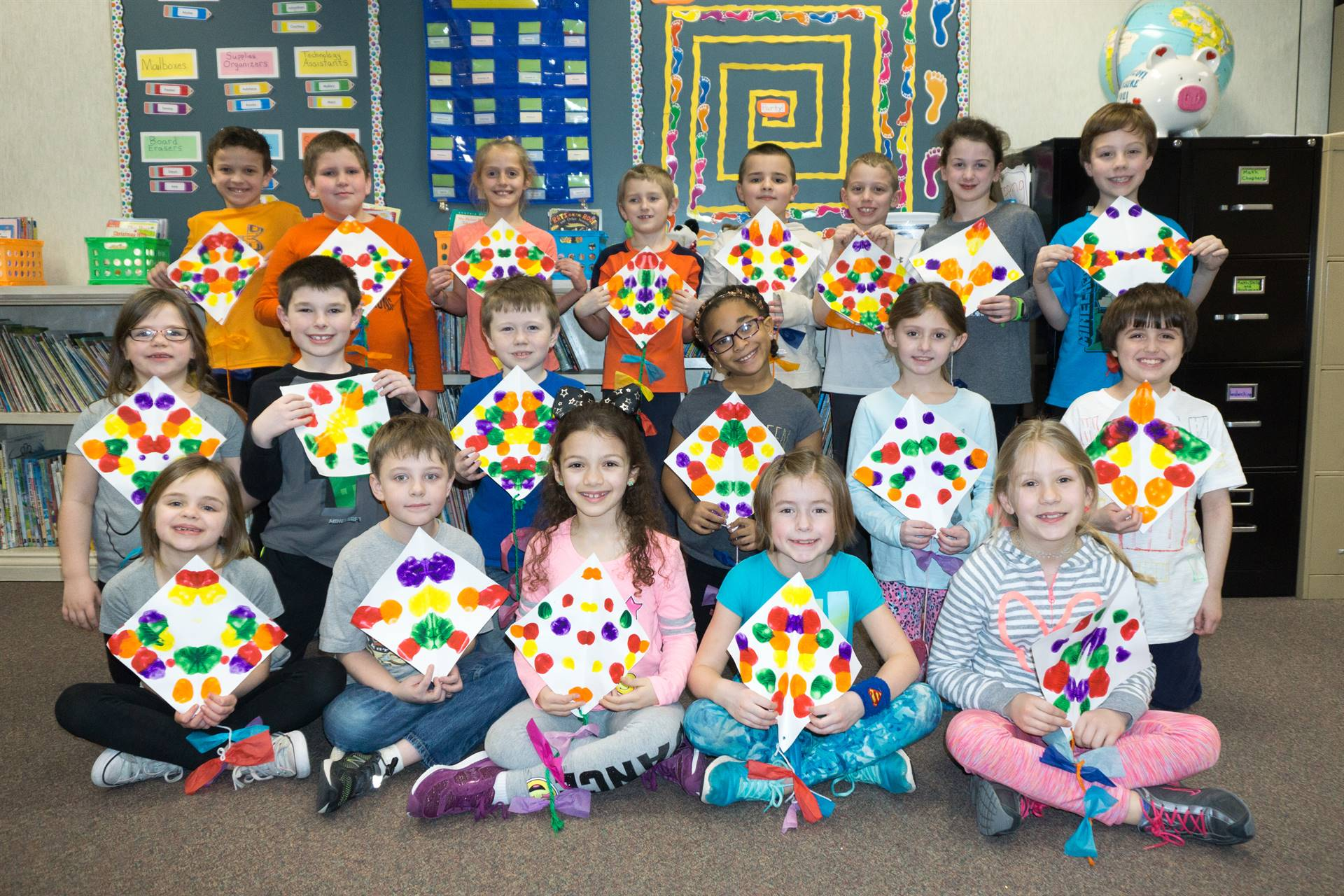 second graders with the kites they made