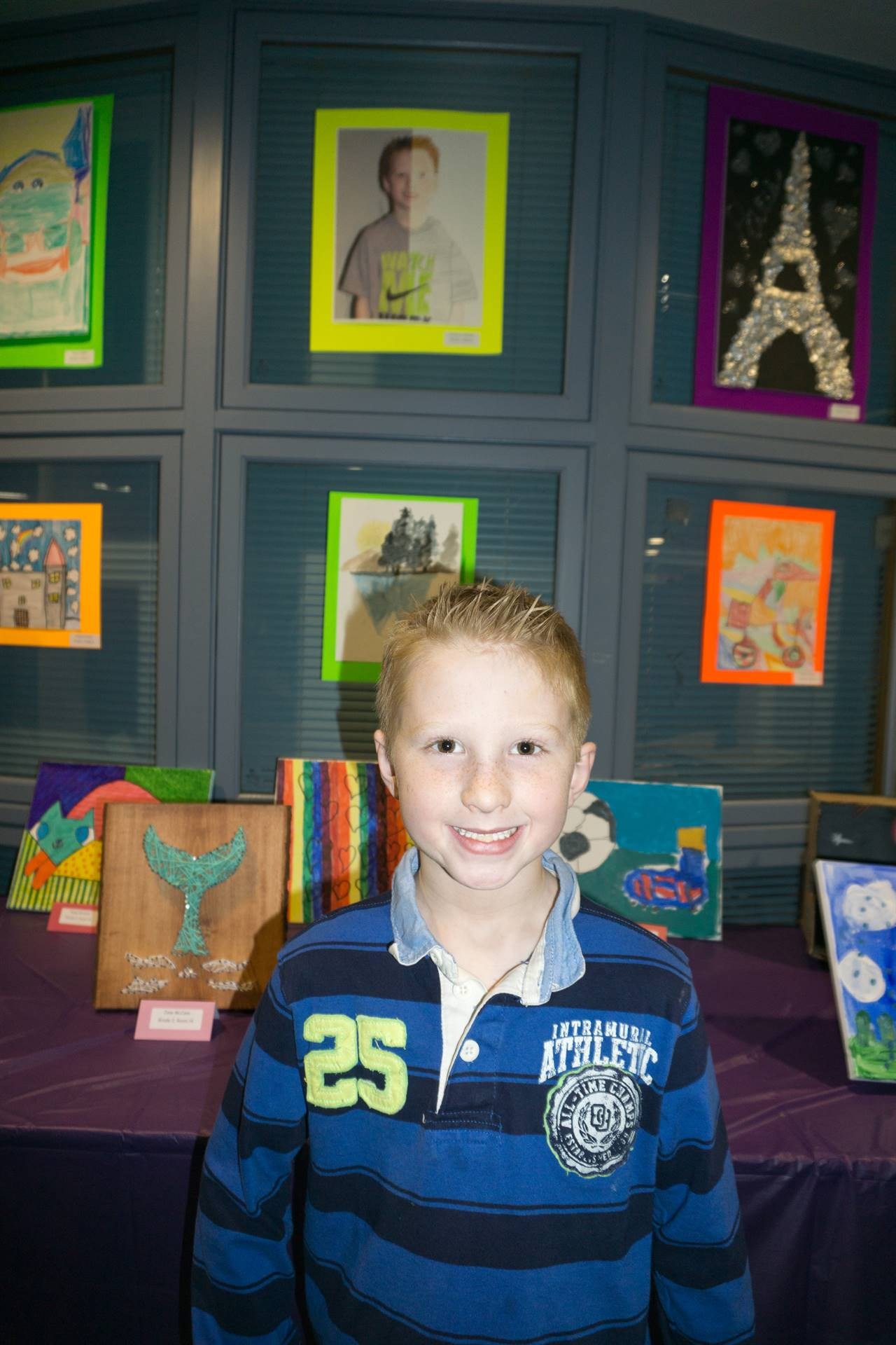Student with his artwork