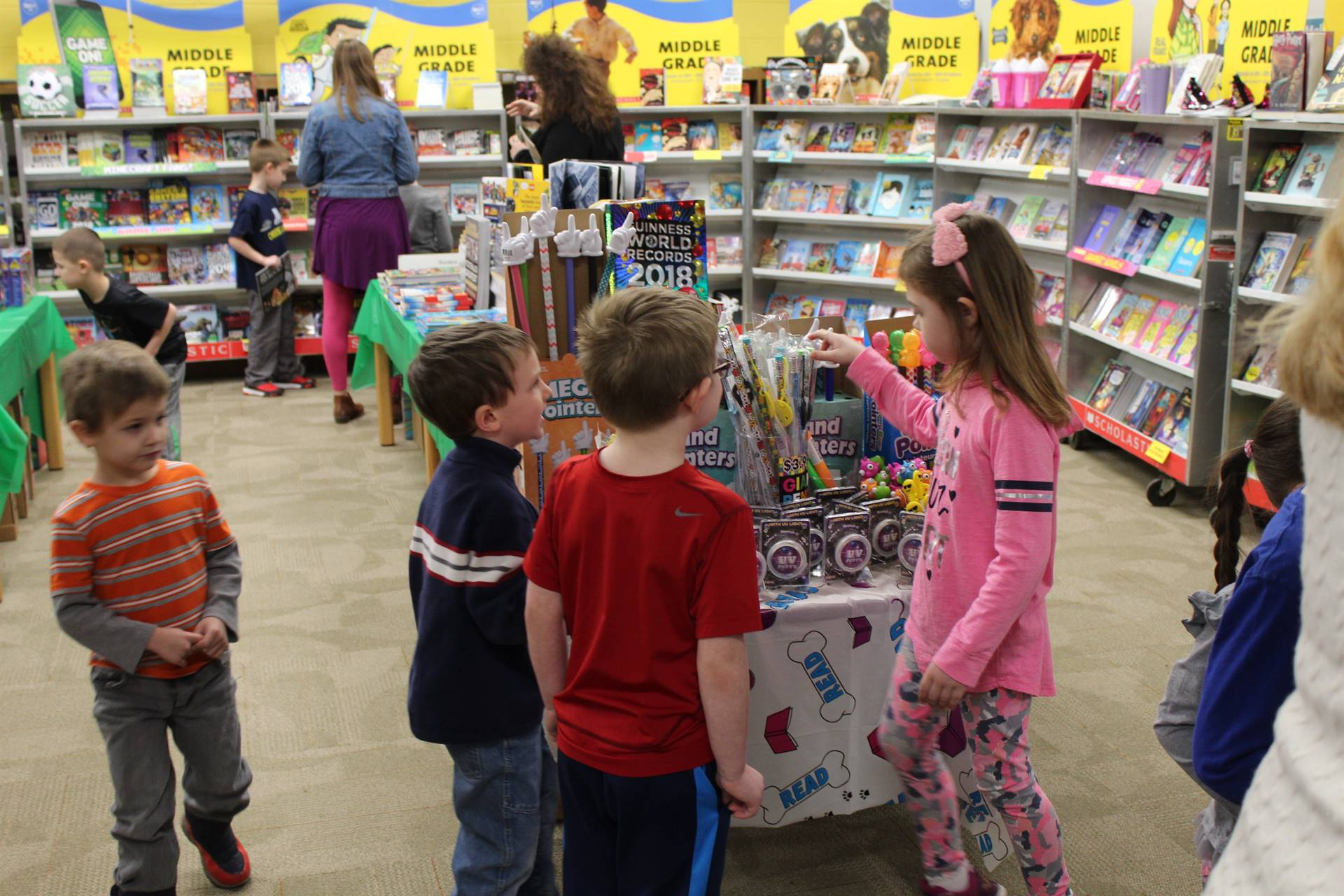 Students looking at items at the book fair