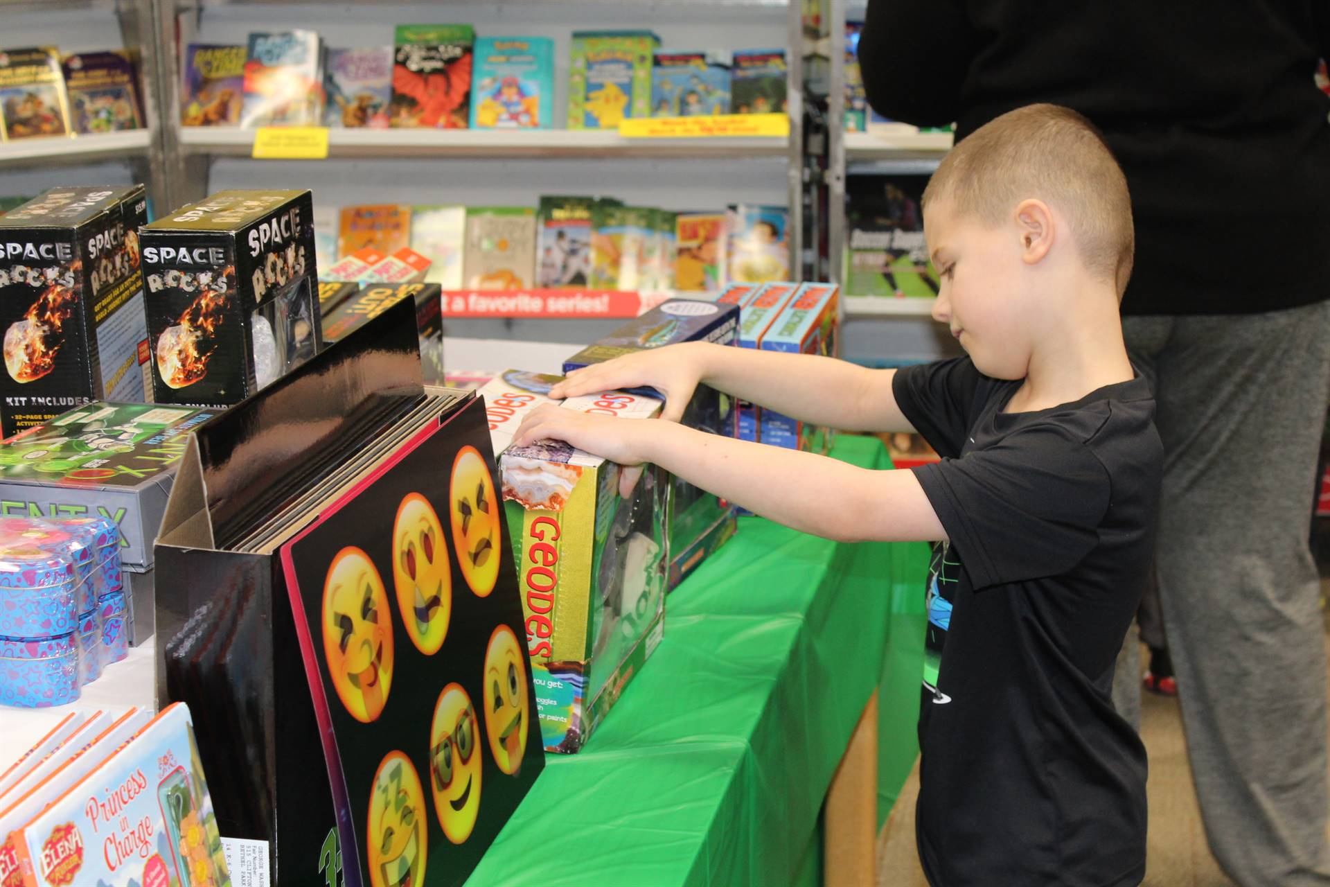 Student looking at item at the book fair