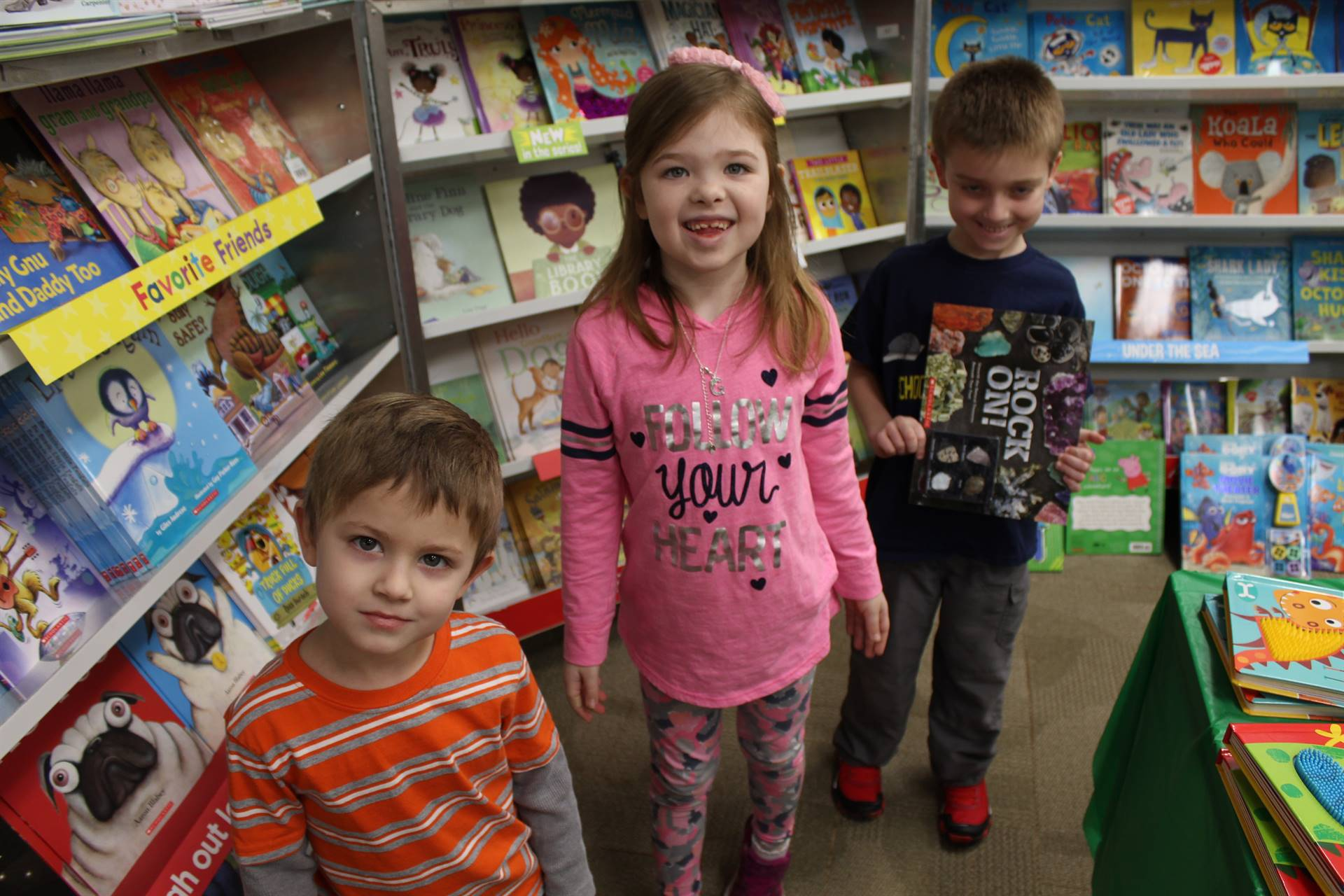 Three students at the book fair