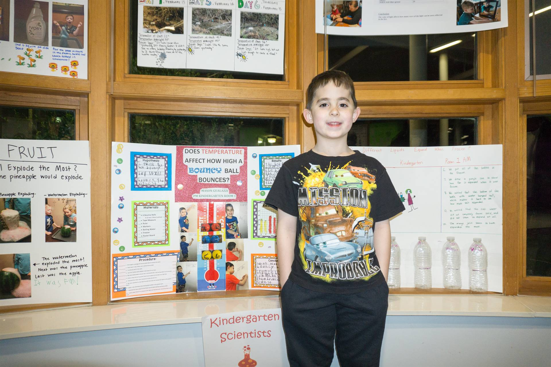 Student with his project at the Science Fair