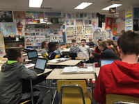 Students participating in a fishbowl discussion