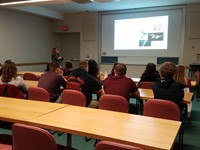 Participating in a lecture at the Supercomputing Center