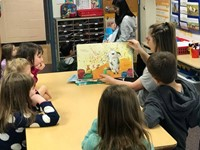 IMS student reading to a group of Lincoln students