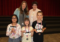 The top three Spellers with BPSD Director of Curriculum and Rotarian