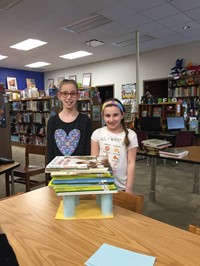Two students with their tower