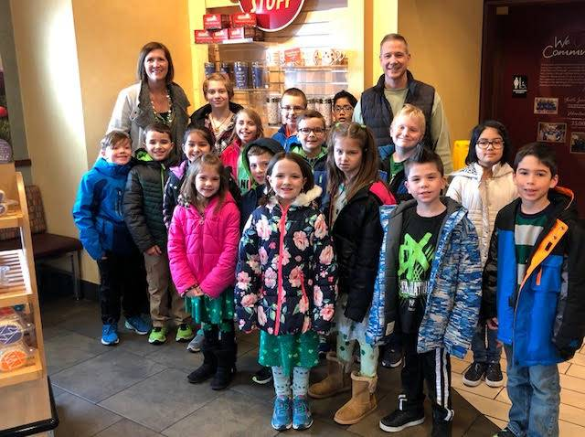 Group of students at Eat'N Park for breakfast with Mr. Chalus and Mrs. Mills
