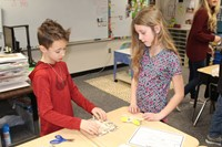 Two students building their boat