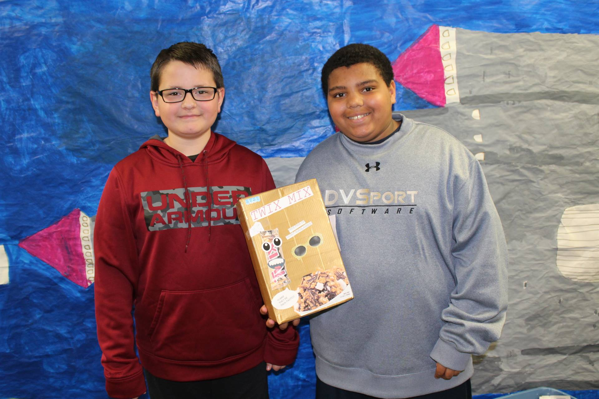 Two Team Gemini students with their cereal box creation