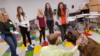 Students looking at a dog handler and his dog