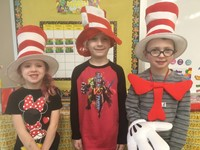 Three students dressed as the Cat in the Hat