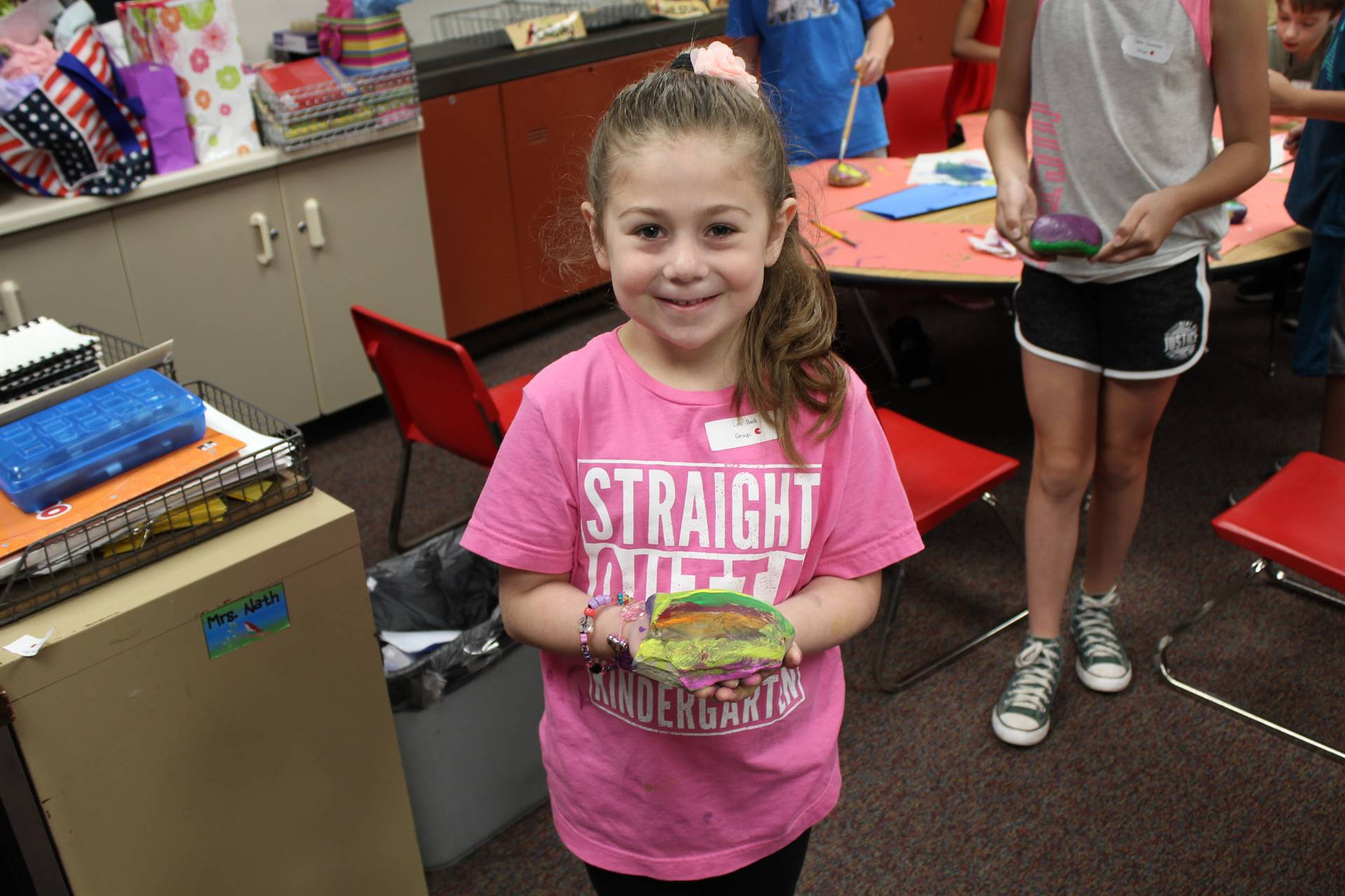 Student with her painted rock on STEAM Day