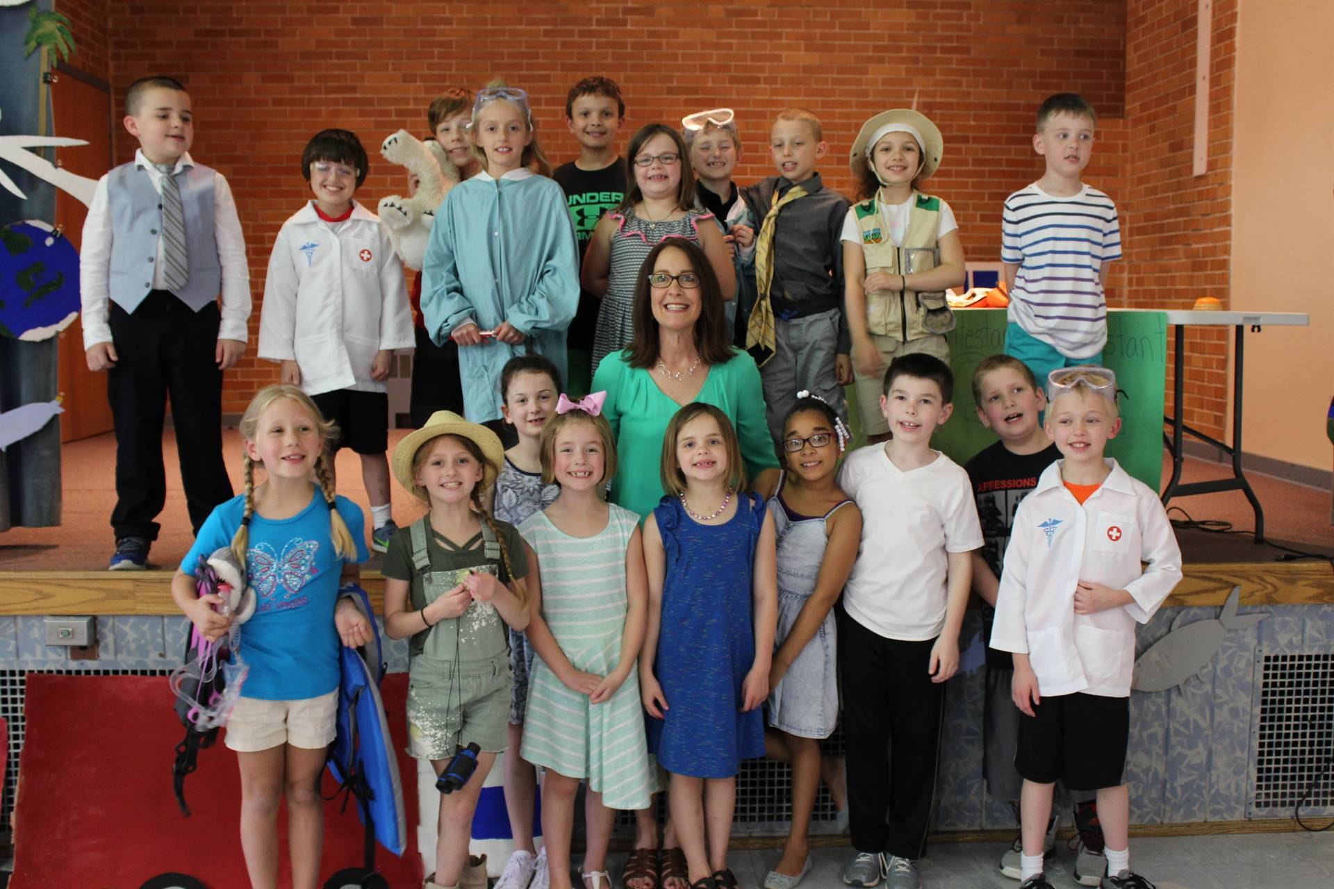 Mrs. Vescovi and the cast of her class play