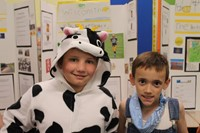 Student dressed as a cow and student dressed as a farmer for Wisconsin