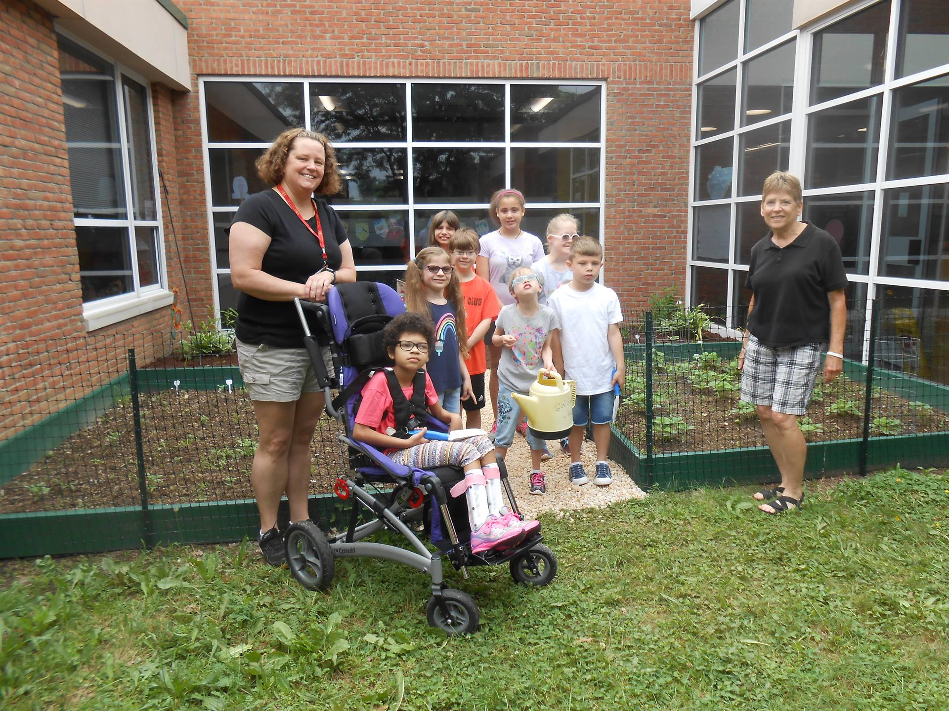 students and teachers in front of the Healthy Living Garden